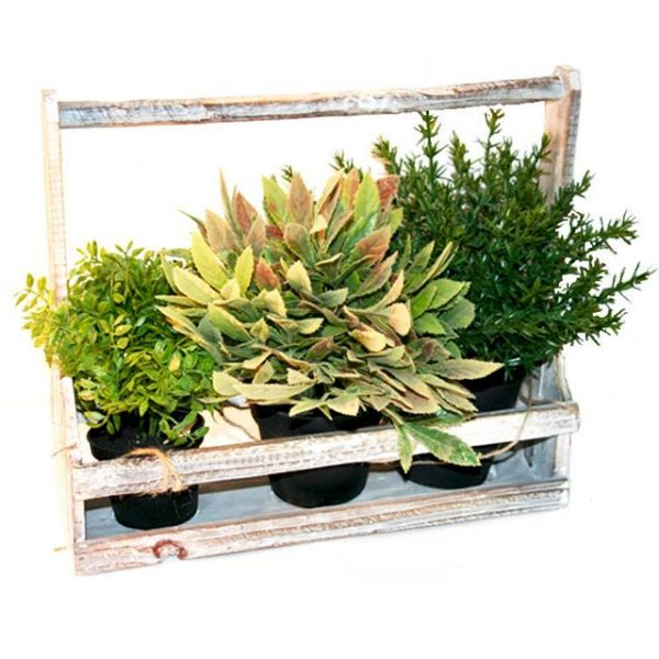 potted artificial herbs in a wooden holder