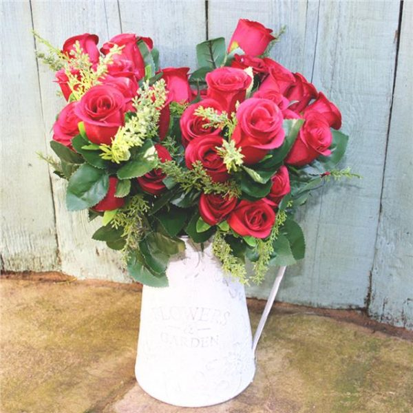 artificial rose bouquet in white jug