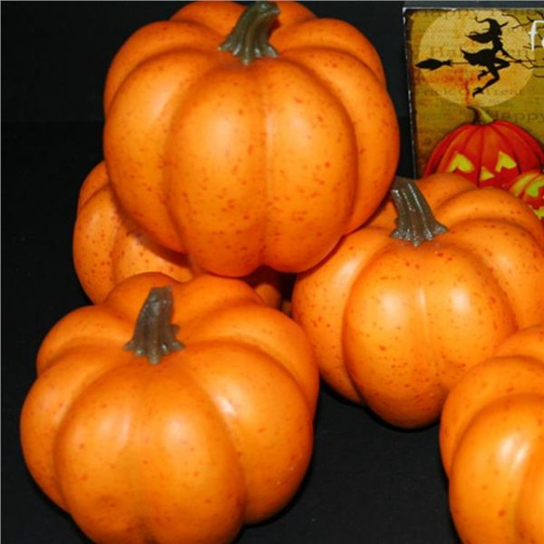 pile of small artificial pumpkins