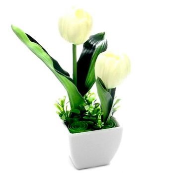 two white artificial tulips in a white pot