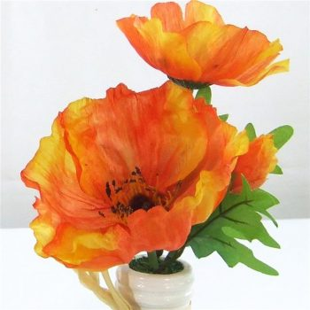 orange artificial poppies in vase
