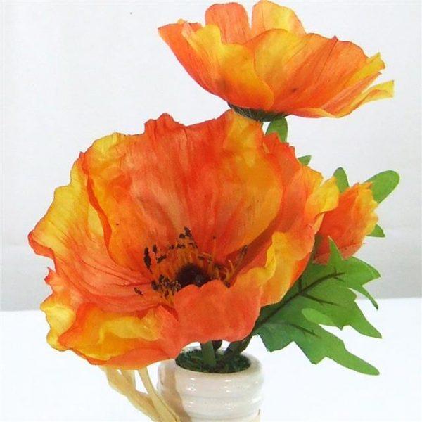 orange artificial poppies in vase