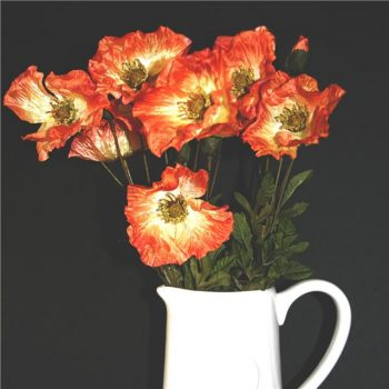 orange silk poppies in a while vase
