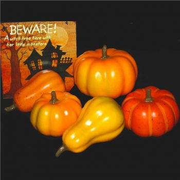 five small fake plastic pumpkins