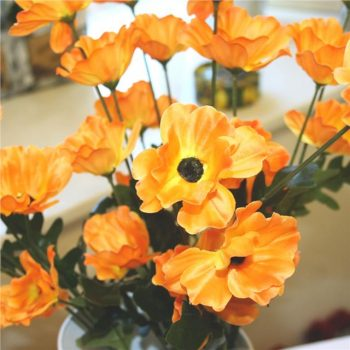 artificial poppies with orange flower
