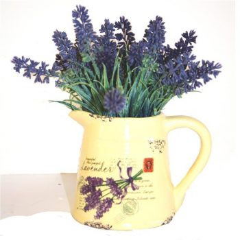 cream jug filled with artificial lavender