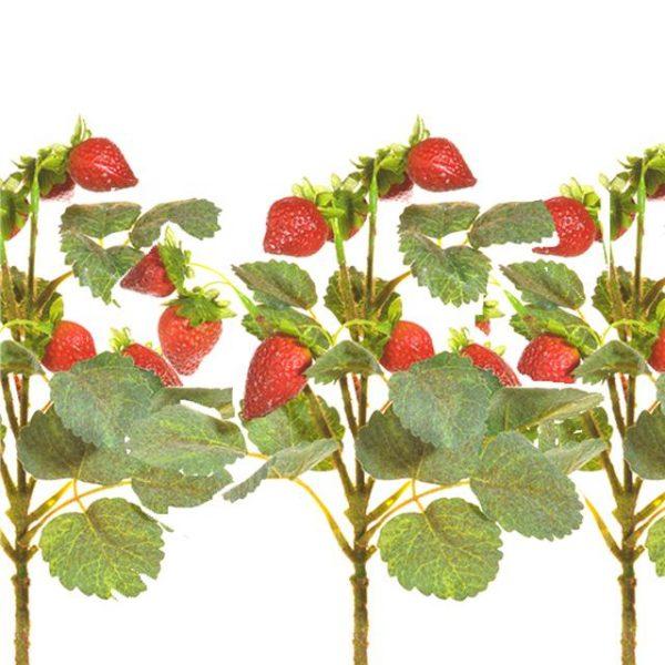 three artificial strawberry picks