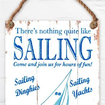 blue and white nautical sign about sailing