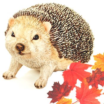 hedgehog ornament with free artificial autumn leaves