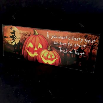 wooden trick or treat plaque with pumpkins