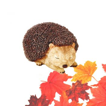 cute hedgehog ornament with artificial maple leaves