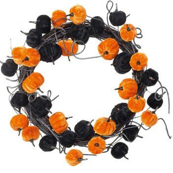 velvet pumpkin wreath with black and orange artificial pumpkins