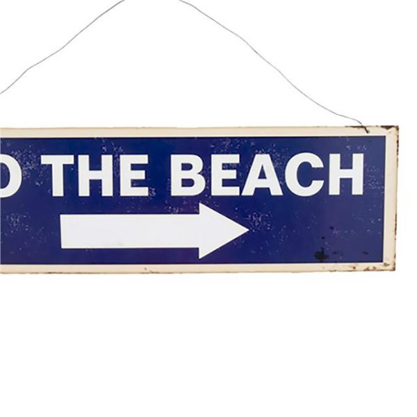 blue and white metal beach sign that says 'to the beach'
