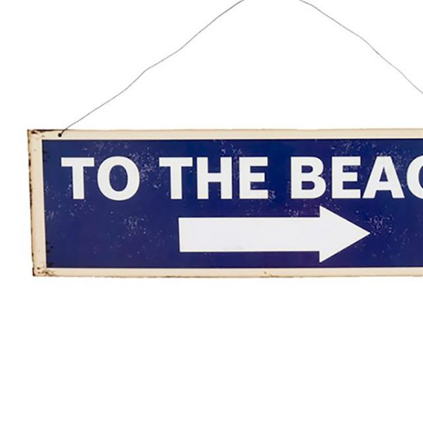 metal beach sign that says 'to the beach'in blue and white