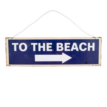 blue metal beach sign that says 'to the beach' in white letters