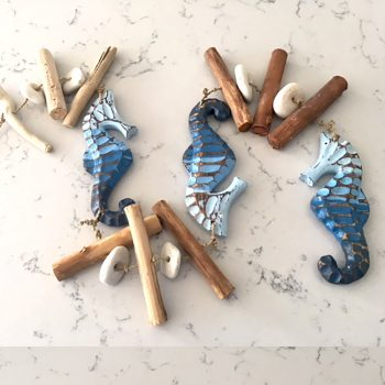 rustic seahorse garland with pebbles and driftwood