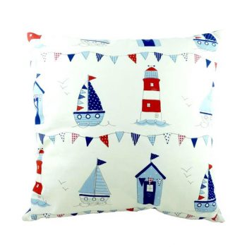 nautical cushion with blue and red boats, beach huts and lighthouses