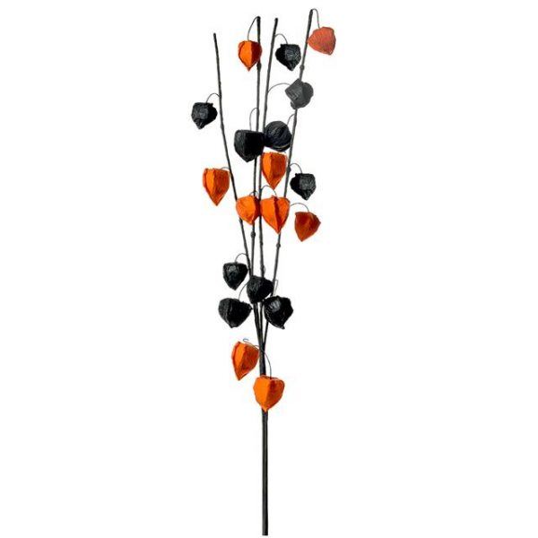 black and orange artificial Chinese lanterns on a branch