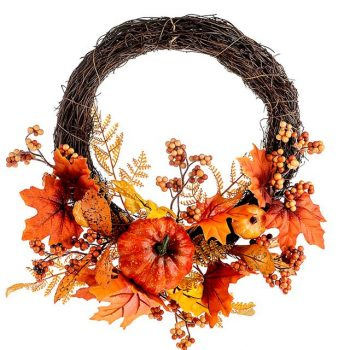 artificial autumn wreath with berries, pumpkins and leaves
