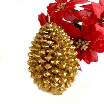 Gold pine cone candle