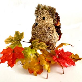 wooden hedgehog ornament with 12 artificial leaves