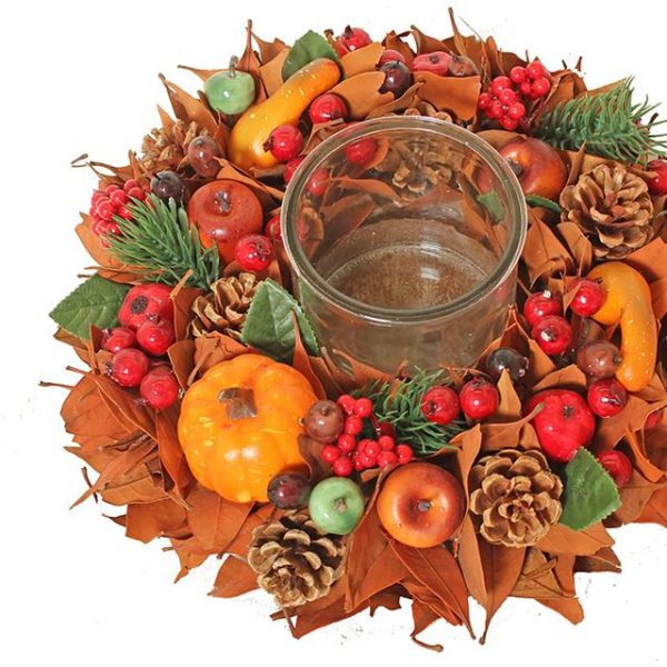 autumn candle holder with berries and pine cones