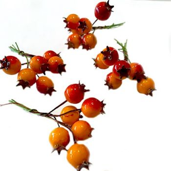 red and orange artificial Christmas berry picks