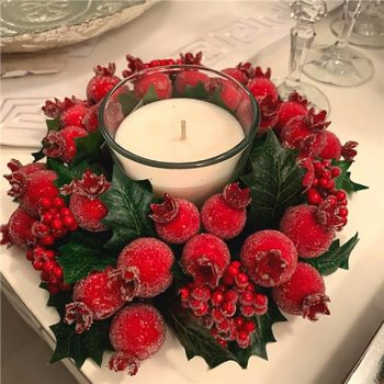 Christmas Candle Ring with green holly red berries and red frosted fruit.